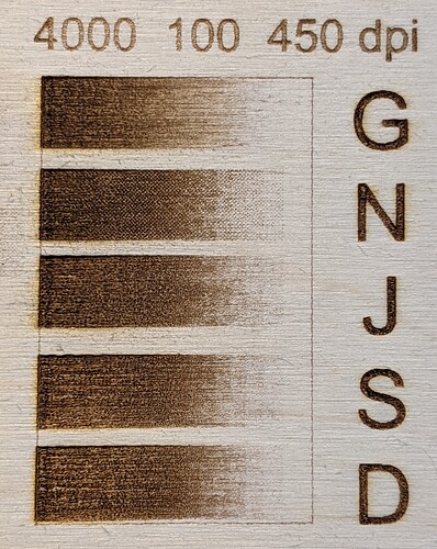 Laser engraved grayscale Joanns plywood at 5 different photo settings